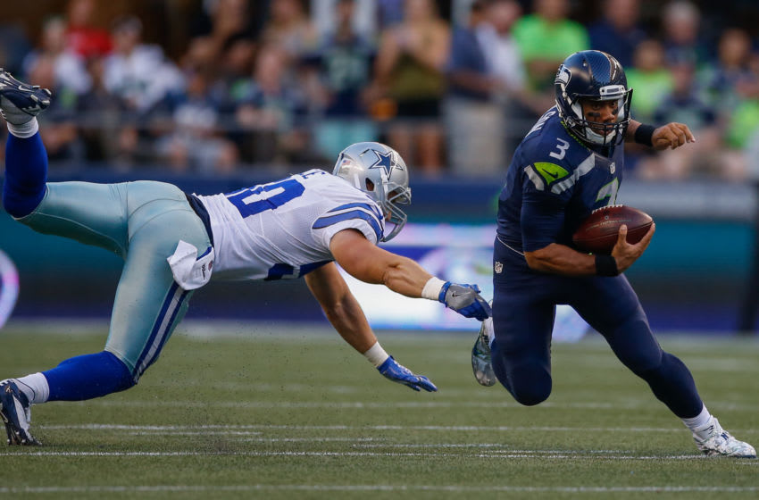 SEATTLE, WA - AUGUST 25: Quarterback Russell Wilson #3 of the Seattle Seahawks rushes against linebacker Sean Lee #50 of the Dallas Cowboys during the preseason game at CenturyLink Field on August 25, 2016 in Seattle, Washington. (Photo by Otto Greule Jr/Getty Images)