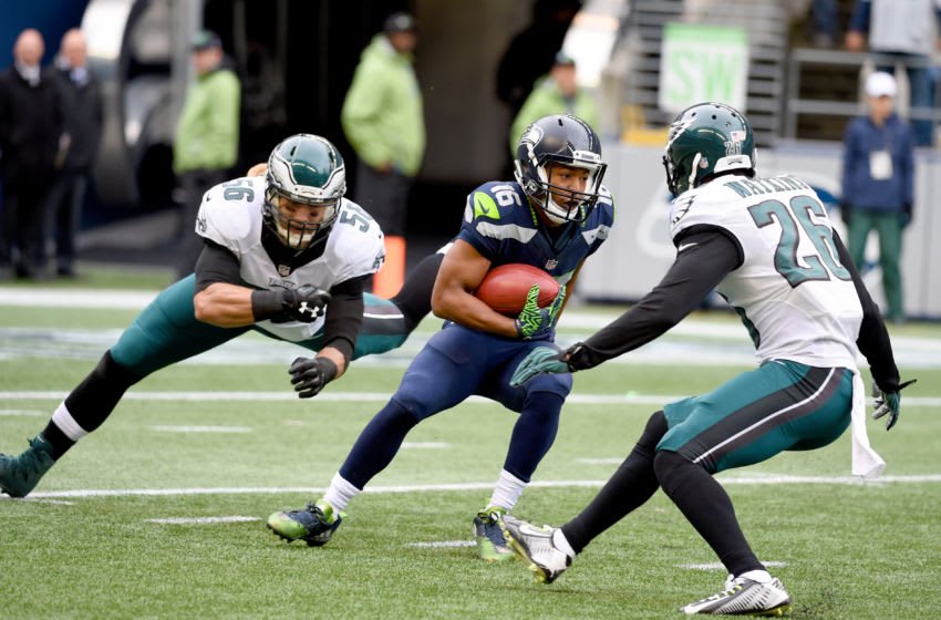 SEATTLE, WA - NOVEMBER 20: Wide receiver Tyler Lockett #16 of the Seattle Seahawks tries to evade the Philadelphia Eagles defense at CenturyLink Field on November 20, 2016 in Seattle, Washington. (Photo by Steve Dykes/Getty Images)