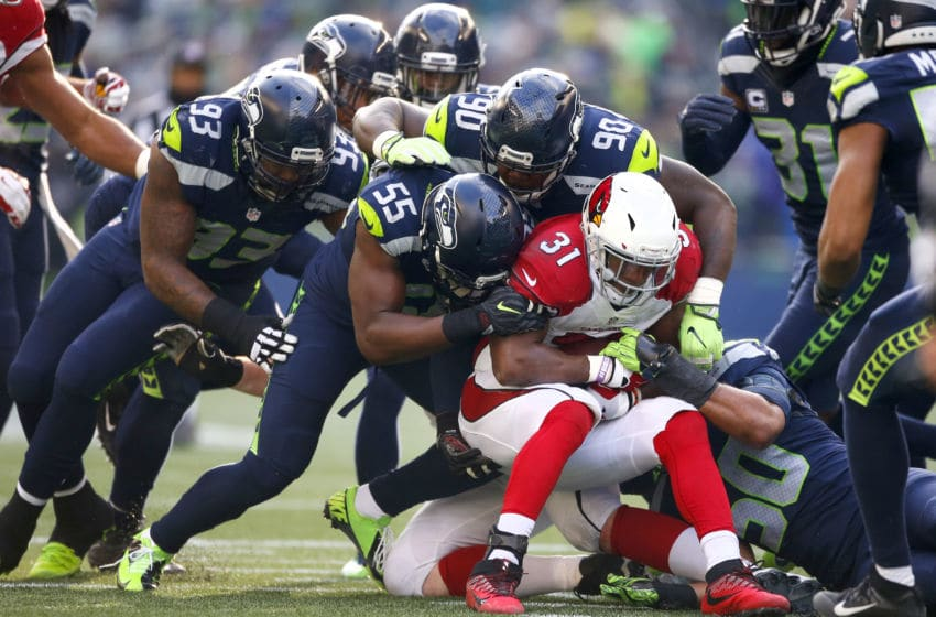 SEATTLE, WA - DECEMBER 24: The Seattle Seahawks defense converge on running back David Johnson #31 of the Arizona Cardinals at CenturyLink Field on December 24, 2016 in Seattle, Washington. (Photo by Otto Greule Jr/Getty Images)