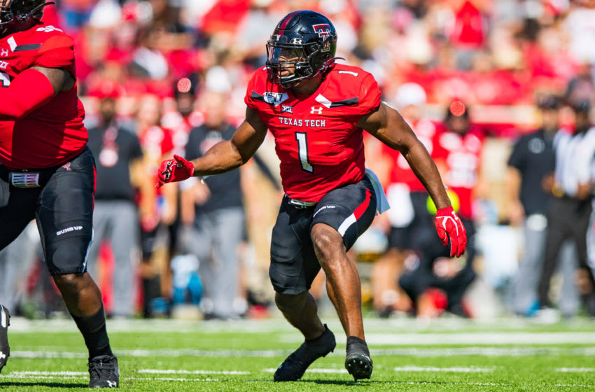 LUBBOCK, TEXAS - OCTOBER 05: Linebacker Jordyn Brooks #1 of the Texas Tech Red Raiders rushes into the backfield during the first half of the college football game against the Oklahoma State Cowboys on October 05, 2019 at Jones AT&T Stadium in Lubbock, Texas. (Photo by John E. Moore III/Getty Images)