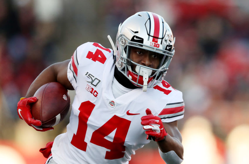 PISCATAWAY, NEW JERSEY - NOVEMBER 16: K.J. Hill #14 of the Ohio State Buckeyes carries the ball in the first quarter against the Rutgers Scarlet Knights at SHI Stadium on November 16, 2019 in Piscataway, New Jersey. (Photo by Elsa/Getty Images)