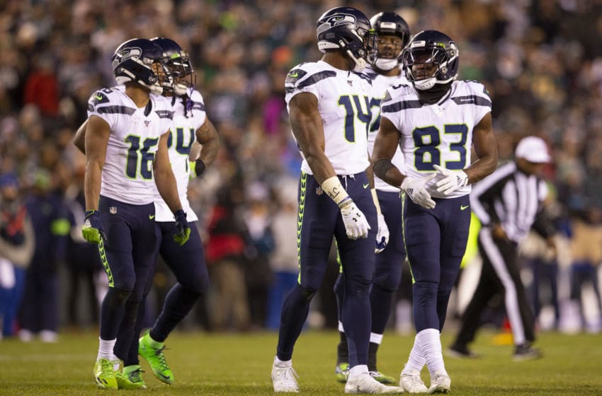 PHILADELPHIA, PA - JANUARY 05: Tyler Lockett #16, Marshawn Lynch #24, D.K. Metcalf #14, and David Moore #83 of the Seattle Seahawks look on during the NFC Wild Card game against the Philadelphia Eagles at Lincoln Financial Field on January 5, 2020 in Philadelphia, Pennsylvania. (Photo by Mitchell Leff/Getty Images)