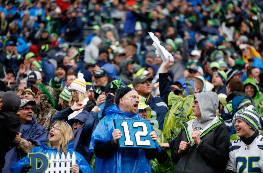 SEATTLE, WA - JANUARY 18: Seattle Seahawks fans celebrate during the second half of the 2015 NFC Championship game against the Green Bay Packers at CenturyLink Field on January 18, 2015 in Seattle, Washington. (Photo by Christian Petersen/Getty Images)