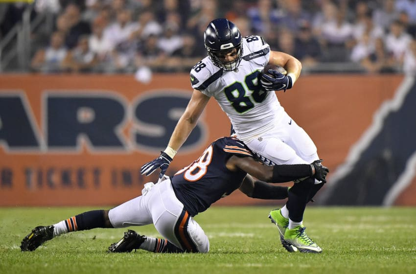 CHICAGO, IL - SEPTEMBER 17: Adrian Amos #38 of the Chicago Bears tackles Will Dissly #88 of the Seattle Seahawks in the first half at Soldier Field on September 17, 2018 in Chicago, Illinois. (Photo by Quinn Harris/Getty Images)