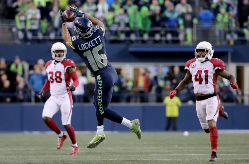 SEATTLE, WA - DECEMBER 30: Tyler Lockett #16 of the Seattle Seahawks catches the ball against the Arizona Cardinals in the fourth quarter during their game at CenturyLink Field on December 30, 2018 in Seattle, Washington. (Photo by Abbie Parr/Getty Images)