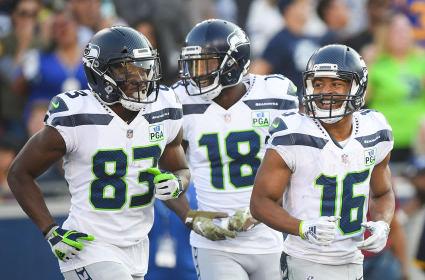LOS ANGELES, CA - NOVEMBER 11: Wide receiver Tyler Lockett #16 of the Seattle Seahawks laughs with teammates David Moore #83 and Jaron Brown #18 after his touchdown catch to take a 21-20 lead in the third quarter against the Los Angeles Rams at Los Angeles Memorial Coliseum on November 11, 2018 in Los Angeles, California. (Photo by Harry How/Getty Images)