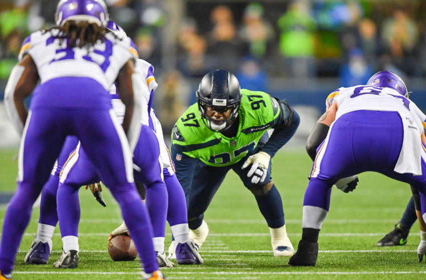 SEATTLE, WASHINGTON - DECEMBER 02: Poona Ford #97 of the Seattle Seahawks awaits the Seattle Seahawks snap during the game at CenturyLink Field on December 02, 2019 in Seattle, Washington. The Seattle Seahawks won, 37-30. (Photo by Alika Jenner/Getty Images)
