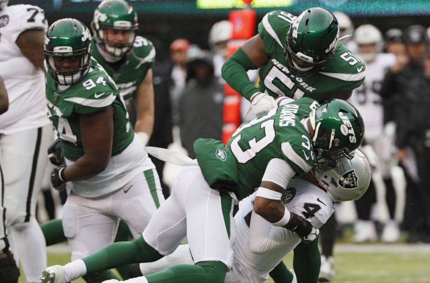 EAST RUTHERFORD, NJ - NOVEMBER 24: Jamal Adams #33 and Brandon Copeland #51 of the New York Jets take down quarterback Derek Carr #4 of the Oakland Raiders for a sack in an NFL football game on November 24, 2019 at MetLife Stadium in East Rutherford, New Jersey. Jets won 34-3. (Photo by Paul Bereswill/Getty Images)