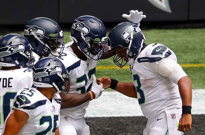 ATLANTA, GEORGIA - SEPTEMBER 13: Russell Wilson #3 of the Seattle Seahawks celebrates with Chris Carson #32 after a touchdown against the Atlanta Falcons at Mercedes-Benz Stadium on September 13, 2020 in Atlanta, Georgia. (Photo by Kevin C. Cox/Getty Images)
