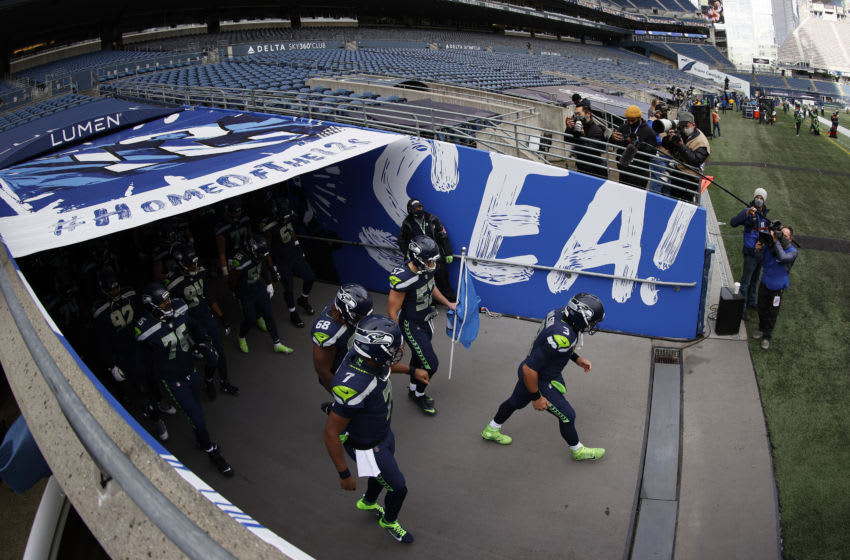 SEATTLE, WASHINGTON - JANUARY 09: Quarterback Russell Wilson #3 of the Seattle Seahawks leads his team onto the field to start the NFC Wild Card Playoff game against the Los Angeles Rams at Lumen Field on January 09, 2021 in Seattle, Washington. (Photo by Steph Chambers/Getty Images)