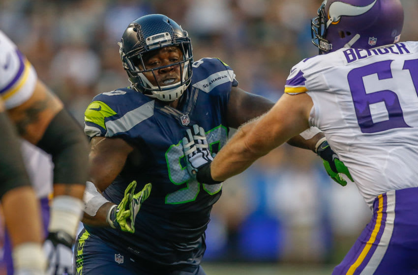 SEATTLE, WA - AUGUST 18: Defensive tackle Jarran Reed #90 of the Seattle Seahawks battles center Joe Berger #61 of the Minnesota Vikings at CenturyLink Field on August 18, 2016 in Seattle, Washington. (Photo by Otto Greule Jr/Getty Images)