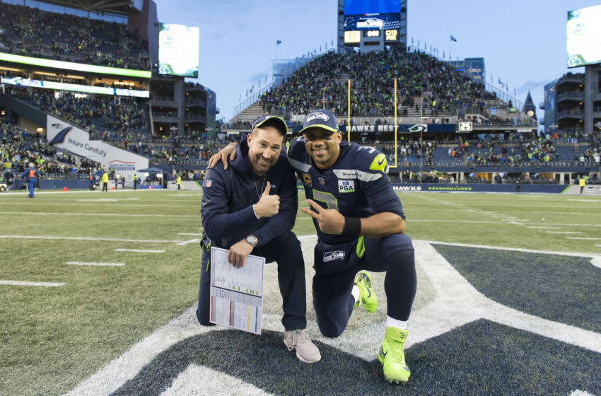Dec 30, 2018; Seattle, WA, USA; Seattle Seahawks offensive coordinator Brian Schottenheimer and Seattle Seahawks quarterback Russell Wilson (3) pose for a photo after the game against the Arizona Cardinals at CenturyLink Field. Seattle defeated Arizona 27-24. Mandatory Credit: Steven Bisig-USA TODAY Sports