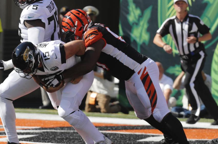 Oct 20, 2019; Cincinnati, OH, USA; Jacksonville Jaguars quarterback Gardner Minshew (15) is sacked by Cincinnati Bengals defensive tackle Geno Atkins (97) during the first half at Paul Brown Stadium. Mandatory Credit: David Kohl-USA TODAY Sports
