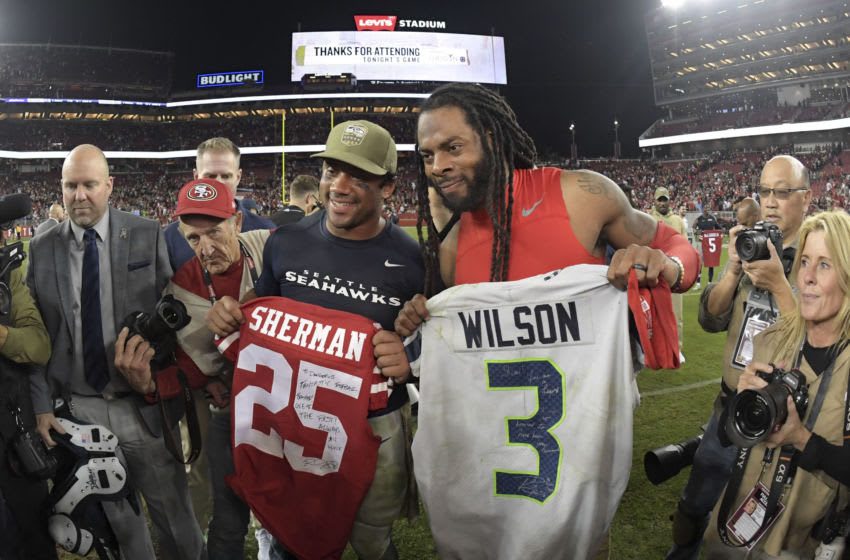 Nov 11, 2019; Santa Clara, CA, USA; Seattle Seahawks quarterback Russell Wilson (left) and San Francisco 49ers cornerback Richard Sherman pose after exchanging jerseys after the game at Levi's Stadium. The Seahaawks defeated the 49ers 27-24. Mandatory Credit: Kirby Lee-USA TODAY Sports