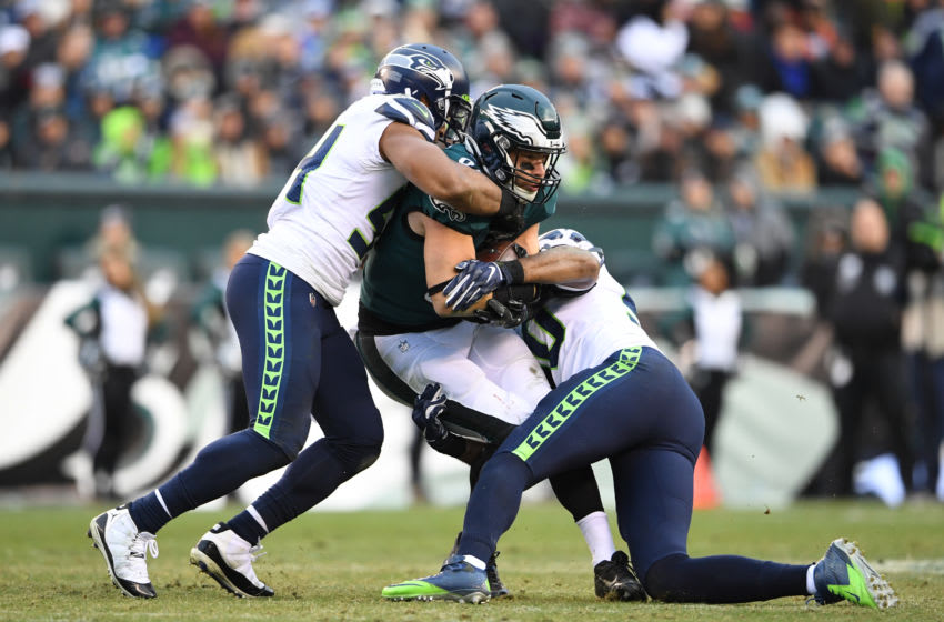 Nov 24, 2019; Philadelphia, PA, USA; Philadelphia Eagles tight end Zach Ertz (86) is tackled by Seattle Seahawks middle linebacker Bobby Wagner (left) and Seattle Seahawks outside linebacker K.J. Wright (right) during the third quarter at Lincoln Financial Field. Mandatory Credit: James Lang-USA TODAY Sports
