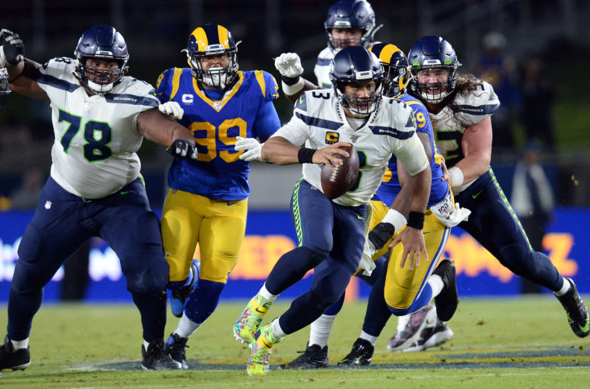 December 8, 2019; Los Angeles, CA, USA; Seattle Seahawks quarterback Russell Wilson (3) runs the ball against the Los Angeles Rams during the second half at the Los Angeles Memorial Coliseum. Mandatory Credit: Gary A. Vasquez-USA TODAY Sports