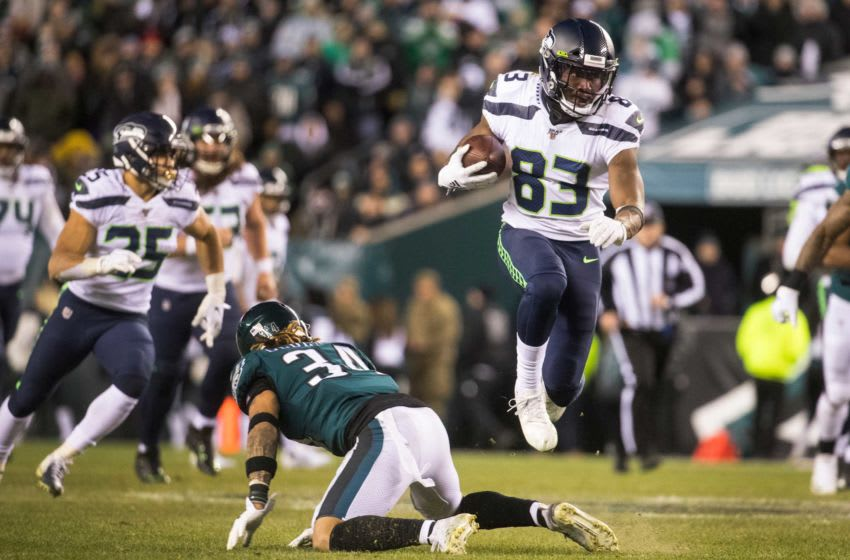 Seattle's David Moore hurdles Philadlephia's Cre'Von LeBlanc (34) Sunday at Lincoln Financial Field. The Seahawks defeated the Eagles ending their season 17-9. Sports Eagles Seahawks