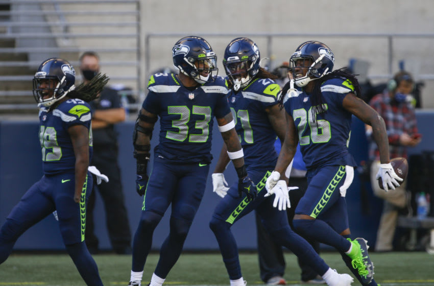 Sep 27, 2020; Seattle, Washington, USA; Seattle Seahawks cornerback Shaquill Griffin (26) celebrates with strong safety Jamal Adams (33), cornerback Tre Flowers (21) and outside linebacker Shaquem Griffin (49) after intercepting a pass against the Dallas Cowboys during the second quarter at CenturyLink Field. Mandatory Credit: Joe Nicholson-USA TODAY Sports