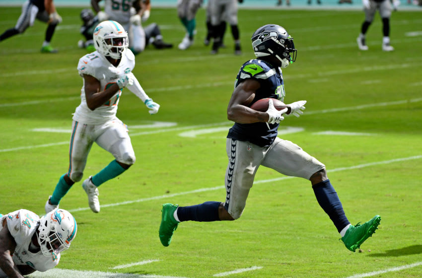Oct 4, 2020; Miami Gardens, Florida, USA; Seattle Seahawks wide receiver DK Metcalf (14) runs the ball against the Miami Dolphins during the second half at Hard Rock Stadium. Mandatory Credit: Jasen Vinlove-USA TODAY Sports