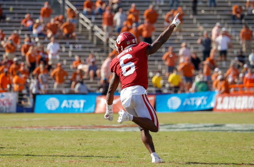 Oct 10, 2020; Dallas, Texas, USA; Oklahoma Sooners defensive back Tre Brown (6) celebrates after making the game winning interception against the Texas Longhorns in overtime of the Red River Showdown at Cotton Bowl. Mandatory Credit: Andrew Dieb-USA TODAY Sports