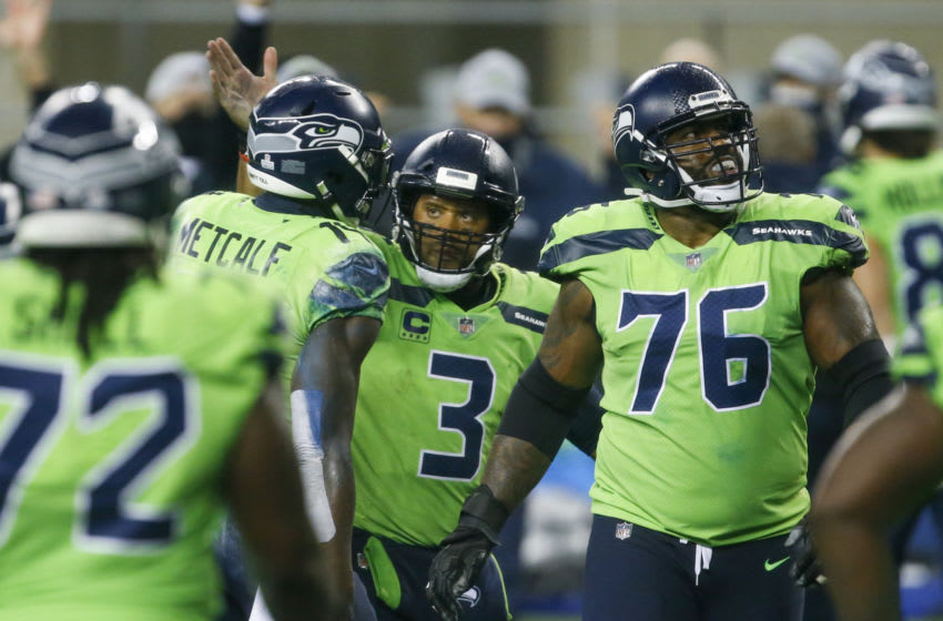 Oct 11, 2020; Seattle, Washington, USA; Seattle Seahawks quarterback Russell Wilson (3) celebrates with wide receiver DK Metcalf (14) following a touchdown against the Minnesota Vikings during the fourth quarter at CenturyLink Field. Seattle Seahawks offensive tackle Duane Brown (76) stands at right. Mandatory Credit: Joe Nicholson-USA TODAY Sports