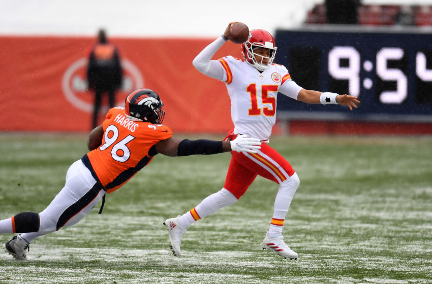 Oct 25, 2020; Denver, Colorado, USA; Denver Broncos defensive end Shelby Harris (96) reaches for Kansas City Chiefs quarterback Patrick Mahomes (15) in the first quarter Empower Field at Mile High. Mandatory Credit: Ron Chenoy-USA TODAY Sports