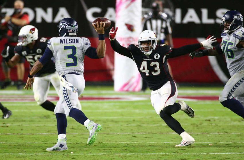 Oct 25, 2020; Glendale, AZ, USA; Seattle Seahawks quarterback Russell Wilson (3) throws a pass with pressure from Arizona Cardinals outside linebacker Haason Reddick (43) in the first half during a game at State Farm Stadium. Mandatory Credit: Rob Schumacher/The Arizona Republic via USA TODAY NETWORK Nfl Seattle Seahawks At Arizona Cardinals