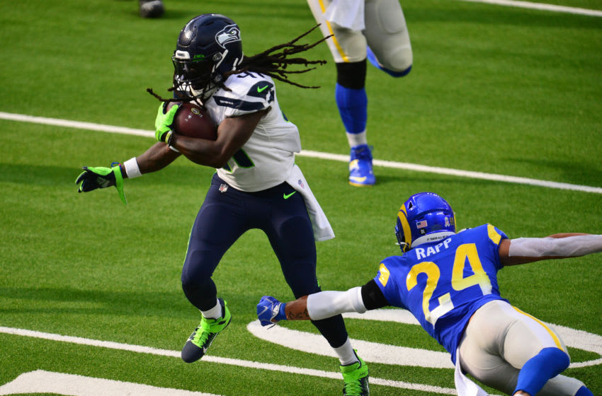 Nov 15, 2020; Inglewood, California, USA; Seattle Seahawks running back Alex Collins (41) runs the ball for a touchdown against Los Angeles Rams safety Taylor Rapp (24) during the first half at SoFi Stadium. Mandatory Credit: Gary A. Vasquez-USA TODAY Sports