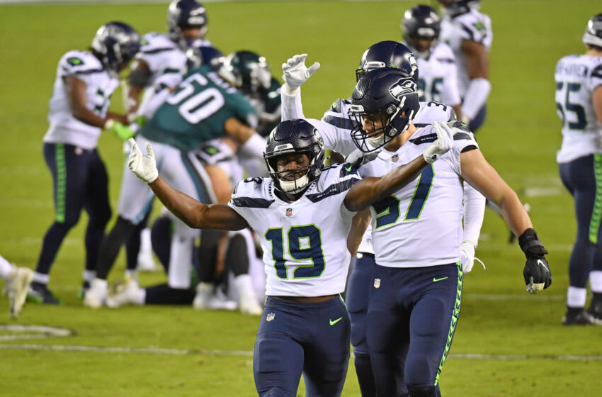 Nov 30, 2020; Philadelphia, Pennsylvania, USA; Seattle Seahawks wide receiver Penny Hart (19) celebrates with linebacker Cody Barton (57) after making a stop against the Philadelphia Eagles during the fourth quarter at Lincoln Financial Field. Mandatory Credit: Eric Hartline-USA TODAY Sports