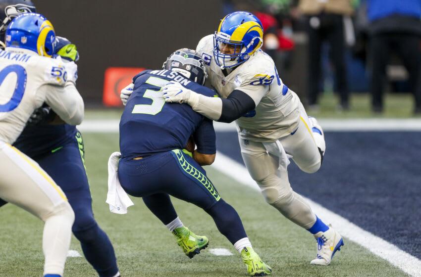 Dec 27, 2020; Seattle, Washington, USA; Los Angeles Rams defensive end Aaron Donald (99) sacks Seattle Seahawks quarterback Russell Wilson (3) during the third quarter at Lumen Field. Mandatory Credit: Joe Nicholson-USA TODAY Sports