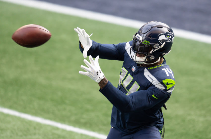 Jan 9, 2021; Seattle, Washington, USA; Seattle Seahawks wide receiver DK Metcalf (14) catches a pass during warmups prior to the game against the Los Angeles Rams at Lumen Field. Mandatory Credit: Steven Bisig-USA TODAY Sports