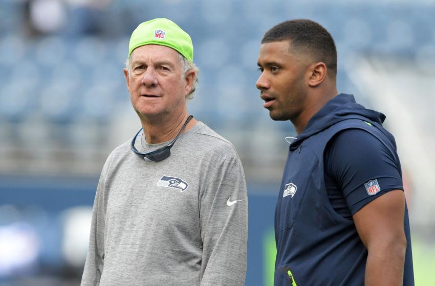 Aug 18, 2017; Seattle, WA, USA; Seattle Seahawks quarterbacks coach Carl Smith (left) and quarterback Russell Wilson. Mandatory Credit: Kirby Lee-USA TODAY Sports