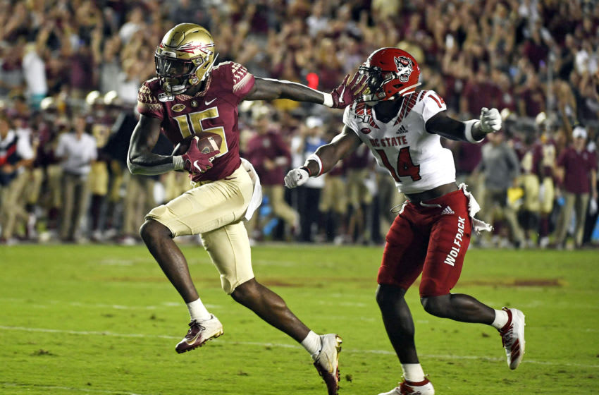 Sep 28, 2019; Tallahassee, FL, USA; Florida State Seminoles wide receiver Tamorrion Terry (15) runs after a catch for a touchdown during the first half past North Carolina State Wolfpack safety De'Von Graves (14) at Doak Campbell Stadium. Mandatory Credit: Melina Myers-USA TODAY Sports