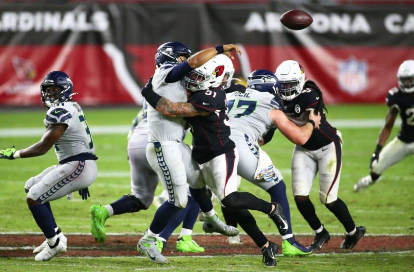 Oct 25, 2020; Glendale, AZ, USA; Arizona Cardinals linebacker Tanner Vallejo (51) tackles Seattle Seahawks quarterback Russell Wilson (3) in overtime during a game at State Farm Stadium. Mandatory Credit: Rob Schumacher/The Arizona Republic via USA TODAY NETWORK Nfl Seattle Seahawks At Arizona Cardinals