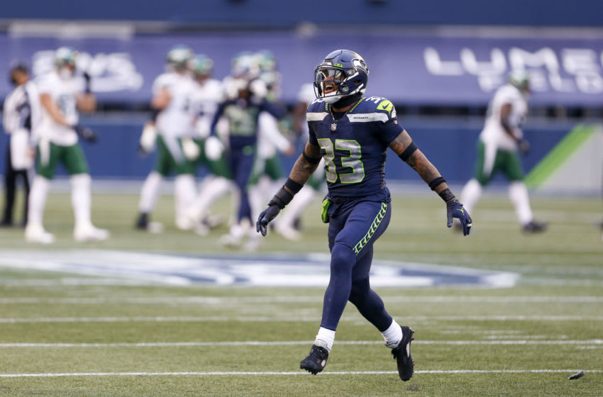 Dec 13, 2020; Seattle, Washington, USA; Seattle Seahawks strong safety Jamal Adams (33) reacts following the a missed field goal attempt by the New York Jets during the second quarter at Lumen Field. Mandatory Credit: Joe Nicholson-USA TODAY Sports