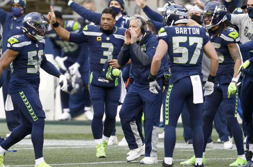 Dec 27, 2020; Seattle, Washington, USA; Seattle Seahawks head coach Pete Carroll and quarterback Russell Wilson (3) react following a fumble by the Los Angeles Rams during the third quarter at Lumen Field. The Rams recovered the football on the play. Seattle Seahawks linebacker Jordyn Brooks (56) is at left. Mandatory Credit: Joe Nicholson-USA TODAY Sports