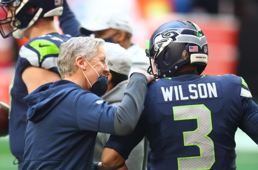 Jan 3, 2021; Glendale, Arizona, USA; Seattle Seahawks head coach Pete Carroll with quarterback Russell Wilson (3) prior to the game against the San Francisco 49ers at State Farm Stadium. Mandatory Credit: Mark J. Rebilas-USA TODAY Sports