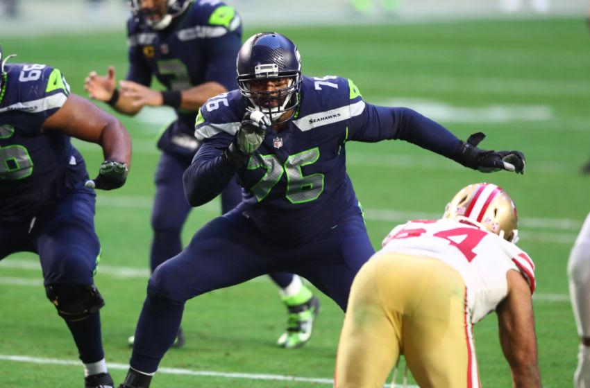 Jan 3, 2021; Glendale, Arizona, USA; Seattle Seahawks offensive tackle Duane Brown (76) against the San Francisco 49ers at State Farm Stadium. Mandatory Credit: Mark J. Rebilas-USA TODAY Sports