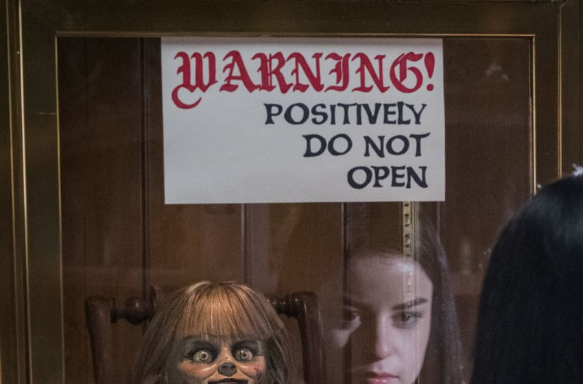 """(L-R) The Annabelle doll and KATIE SARIFE as Daniela in New Line Cinema's horror film """"ANNABELLE COMES HOME,"""" a Warner Bros. Pictures release."""