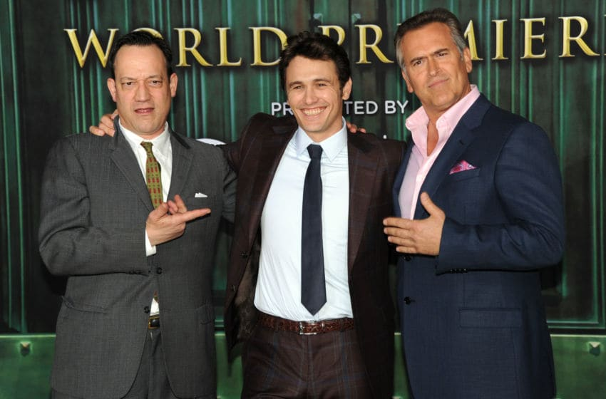 HOLLYWOOD, CA - FEBRUARY 13: (L-R) Actors Ted Raimi, James Franco and Bruce Campbell attend the world premiere of Walt Disney Pictures'