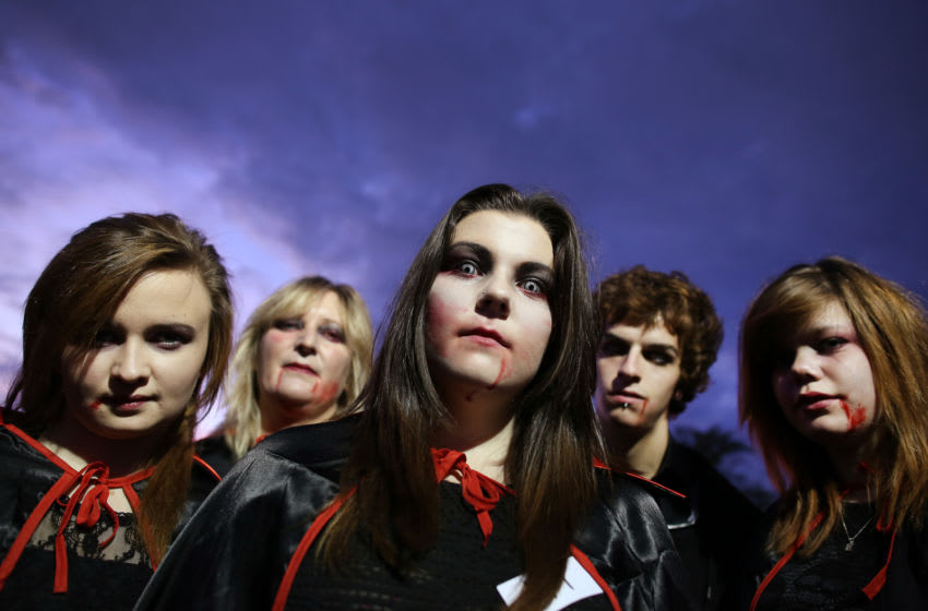 CRAWLEY, WEST SUSSEX - OCTOBER 05: Young vampires at the Shocktober Fest at Tulleys Farm on October 5, 2013 near Crawley, West Sussex. Each October thousands attend the United Kingdom's biggest Halloween themed attraction which includes six different haunted attractions and rides. The event set a new UK record for the biggest gathering of vampires, but missed out on breaking the world record. (Photo by Peter Macdiarmid/Getty Images)
