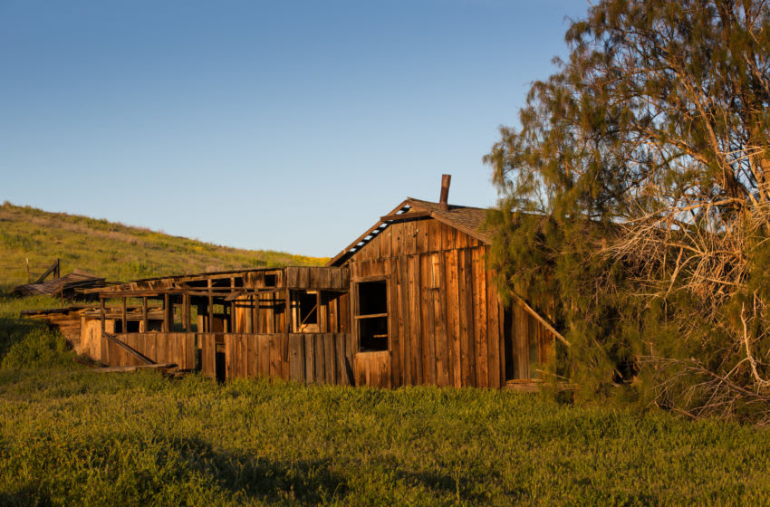 CARRIZO PLAIN NATIONAL MONUMENT, CA - MARCH 29: An old abandoned farmhouse at Traver Ranch is located in the heart of the preserve as viewed on March 29, 2017, in Carrizo Plain National Monument, California. Located in the southeastern corner of San Luis Obispo County between the Temblor and Caliente mountain ranges, this 43-mile- long high valley is experiencing an epic wildflower