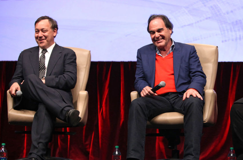 Sam Raimi and Oliver Stone (Photo by Ryan Miller/Getty Images for CinemaCon)