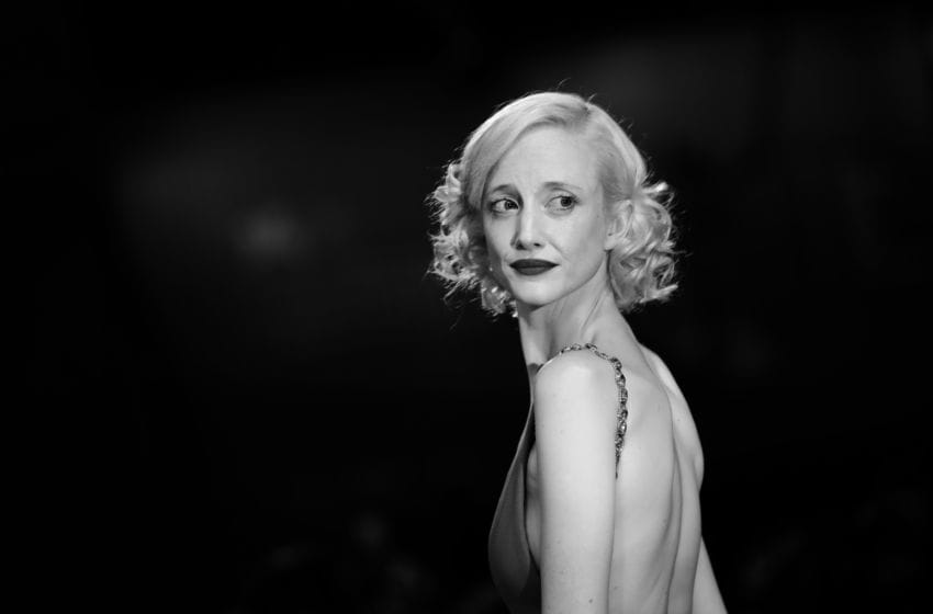 VENICE, ITALY - SEPTEMBER 05: [Editor's Note: Image was converted to black and white] Andrea Riseborough walks the red carpet ahead of the