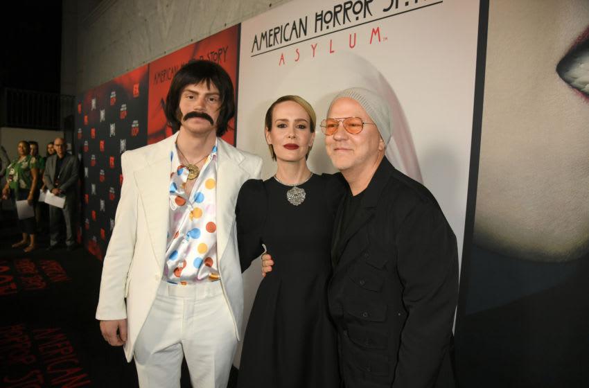 HOLLYWOOD, CALIFORNIA - OCTOBER 26: (L-R) Evan Peters, Sarah Paulson, and Ryan Murphy attend FX's