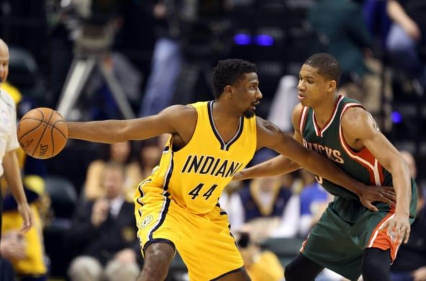 Mar 12, 2015; Indianapolis, IN, USA; Indiana Pacers forward Solomon Hill (3) posts up against Milwaukee Bucks guard Giannis Antekounmpo (34) at Bankers Life Fieldhouse. Mandatory Credit: Brian Spurlock-USA TODAY Sports