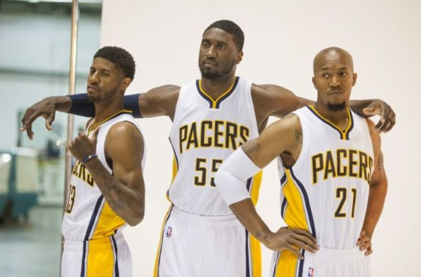 Sep 29, 2014; Indianapolis, IN, USA; Indiana Pacers forward Paul George (13), center Roy Hibbert (55) and forward David West (21) during media day at Bankers Life Fieldhouse. Mandatory Credit: Trevor Ruszkowski-USA TODAY Sports
