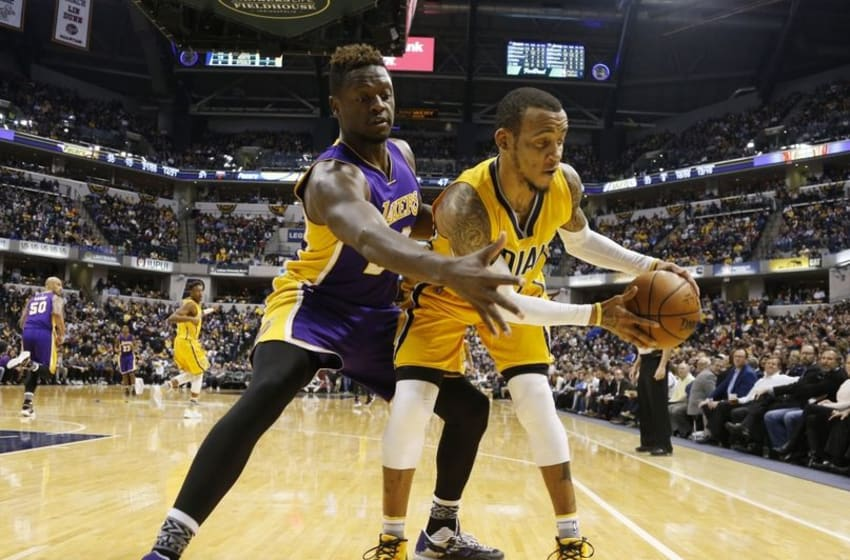 Feb 8, 2016; Indianapolis, IN, USA; Los Angeles Lakers forward Julius Randle (30) defends Indiana Pacers guard Monta Ellis (11) at Bankers Life Fieldhouse. The Indiana Pacers defeat the Los Angeles Lakers 89-87. Mandatory Credit: Brian Spurlock-USA TODAY Sports