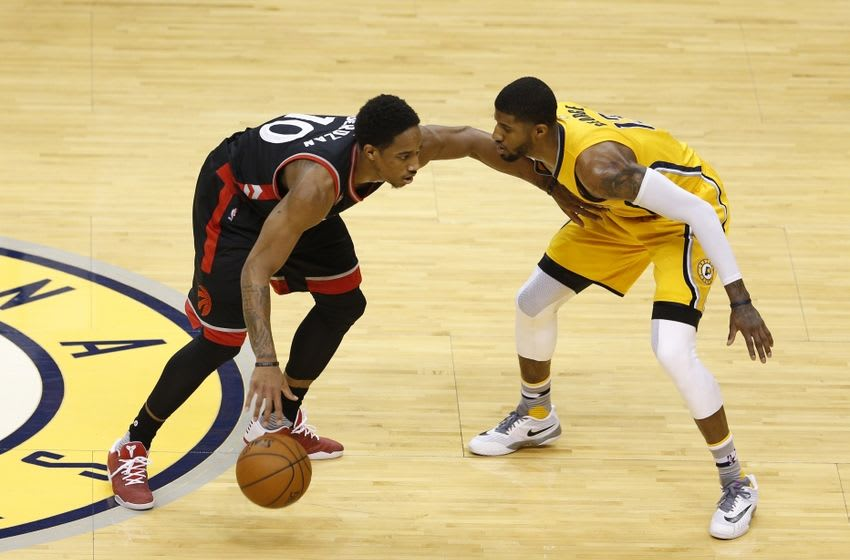 Apr 21, 2016; Indianapolis, IN, USA; Toronto Raptors forward DeMar DeRozan (10) is guarded by Indiana Pacers forward Paul George (13) in the first quarter in game three of the first round of the 2016 NBA Playoffs at Bankers Life Fieldhouse. Mandatory Credit: Brian Spurlock-USA TODAY Sports