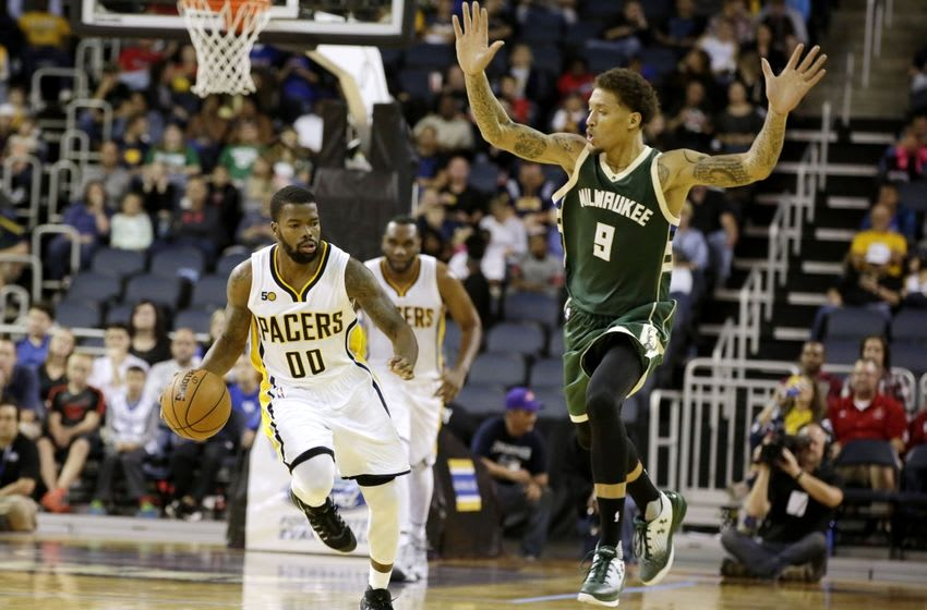 Oct 12, 2016; Evansville, IN, USA; Indiana Pacers guard Aaron Brooks (00) works past Milwaukee Bucks forward Michael Beasley (9) during a game at Ford Center. Mandatory Credit: James Brosher-USA TODAY Sports